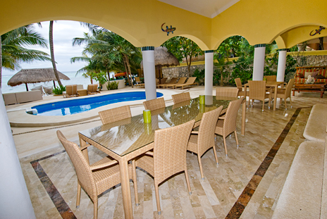 Poolside dining area on the patio at Villa Iguana Soliman Bay vacation rental villa