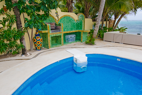 Built in barbecue by the pool at Villa Iguana vacation rental villa on Soliman Bay