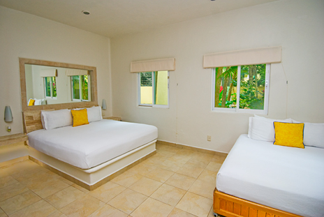 Bedroom in the garden casita at Villa Iguana Soliman Bay vacation rental property