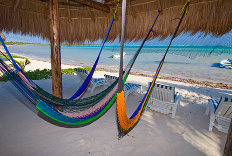 Hammocks in the palapa on the beach at Villa Iguana Soliman Bay vacation rental villa