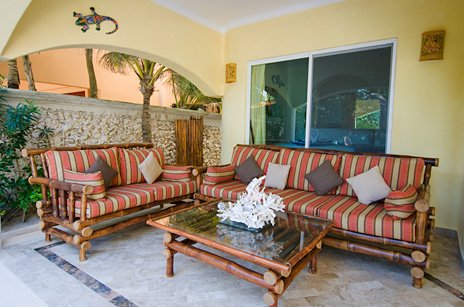 Outdoor living area on the patio at Villa Iguana Soliman Bay vacation rental villa