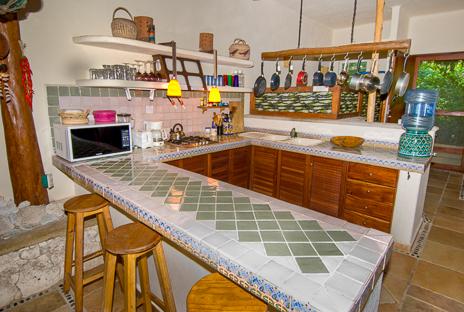 Fully equipped kitchen at  Casa Yamulkan vacation rental villa on Soliman Bay