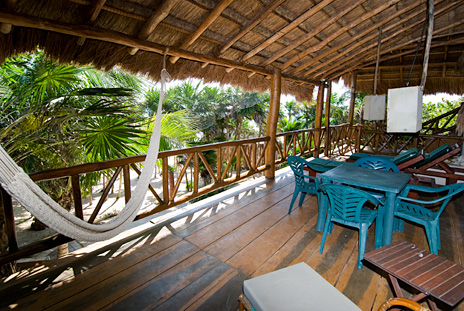 Hammocks on the second level patio at  Casa Yamulkan vacation rental villa on Soliman Bay