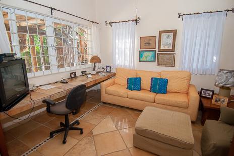 TV and computer room at  Casa Yamulkan vacation rental villa on Soliman Bay