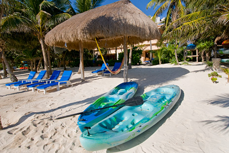 Kayaks on the beach at Villa Yardena Soliman Bay Luxury Vacation Rental Home