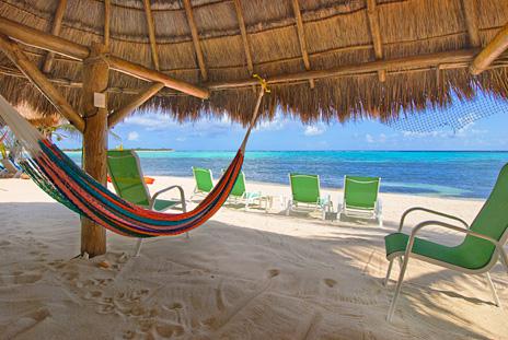 Palapa on the beach at Nah Yaxche vacation rnetal villa on Soliman Bay